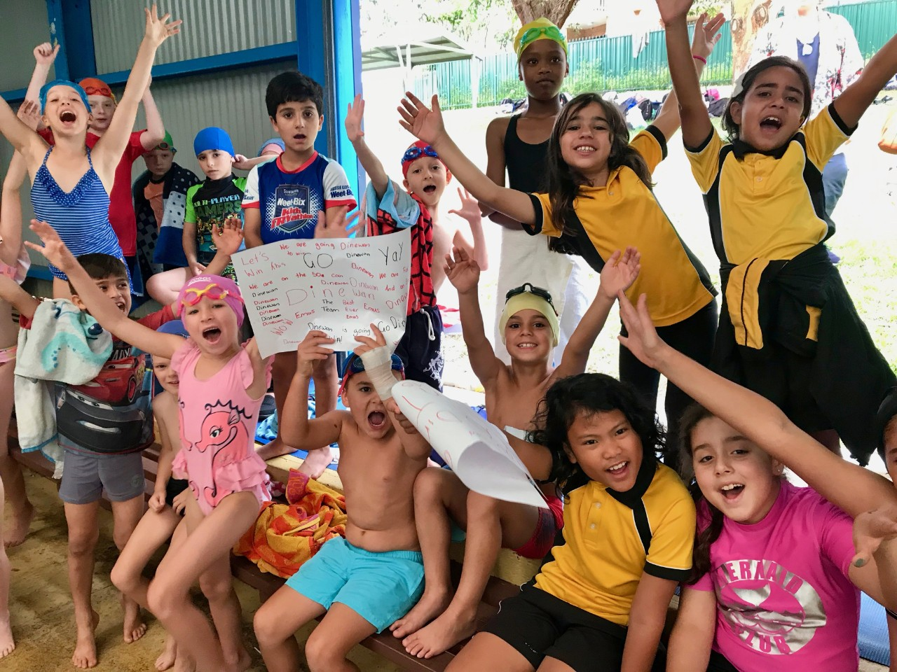 Students cheering and supporting one another at the school swimming carnival.